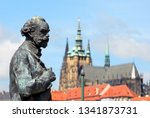 Statue of Antonin Dvorak with St. Vitus Cathedral in the background in Prague, Czech Republic