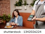 waiter with payment terminal in ... | Shutterstock . vector #1342026224