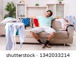 young man husband ironing at... | Shutterstock . vector #1342033214