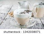 Small photo of Tea latte, Earl Grey Hot London Fog Tea Drink with Foamed Milk, wooden background copy space