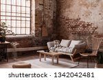 pouf and wooden table on rug in ... | Shutterstock . vector #1342042481