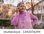 portrait of a happy senior... | Shutterstock . vector #1342076294