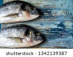 Stock photo rustic style fish pattern herring fish on an old blue wooden background flat lay copy space 1342139387