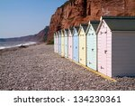 Beach Huts And Sandstone Cliff...