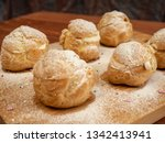 delicious tender profiteroles | Shutterstock . vector #1342413941