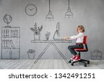 happy child sitting at the desk ... | Shutterstock . vector #1342491251