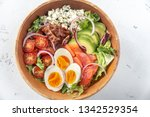 bowl of cobb salad on the table | Shutterstock . vector #1342529354