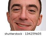 Caucasian Male Headshot Smiling - Extreme Closeup - stock photo