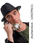 Headshot of a Caucasian Male Wearing a Fedora Style Hat and Talking on the Phone - Slightly Angled - stock photo