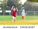 kids play with water on hot...   Shutterstock . vector #1342616267