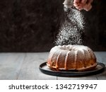 Woman\'s Hand Sprinkling Icing...