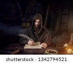 Medieval Monk In Robe Writes...