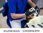 man at dentist clinic gets... | Shutterstock . vector #1342846394