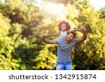 portrait of young father... | Shutterstock . vector #1342915874