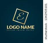 letter e gold logo concept....