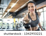smiling young woman working out ... | Shutterstock . vector #1342953221