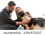 couple in love with a dog in...   Shutterstock . vector #1342972337