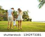 family walk in the park  happy...   Shutterstock . vector #1342973381