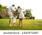 family walk in the park  happy...   Shutterstock . vector #1342973387