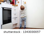 a little cute boy wants to open ... | Shutterstock . vector #1343030057