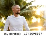 fashion guy standing at sunset...   Shutterstock . vector #1343095997