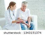 elderly man at the doctor  | Shutterstock . vector #1343151374