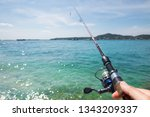 fisherman hold fishing rod... | Shutterstock . vector #1343209337
