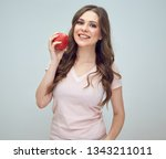 woman with toothy smile holding ... | Shutterstock . vector #1343211011