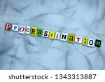 Stock photo word procrastination of cut letters on gray background psychologic concept headline 1343313887