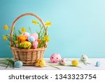 basket of easter eggs and... | Shutterstock . vector #1343323754
