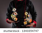 closeup of master chef holding... | Shutterstock . vector #1343354747