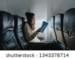 beautiful girl in hat sitting...   Shutterstock . vector #1343378714