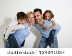 family of four standing on... | Shutterstock . vector #134341037