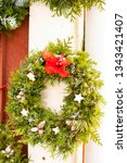 christmas wreath on the wall | Shutterstock . vector #1343421407
