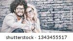 portrait of happy young couple... | Shutterstock . vector #1343455517