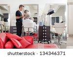 male hairstylist straightening... | Shutterstock . vector #134346371
