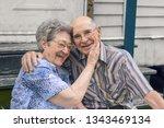 an elderly couple is sitting... | Shutterstock . vector #1343469134