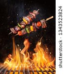Small photo of Tasty skewers flying above cast iron grate with fire flames. Freeze motion barbecue concept.