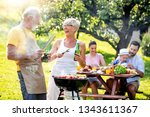 family having a barbecue in a...   Shutterstock . vector #1343611367