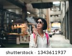 asian woman traveling and... | Shutterstock . vector #1343611937