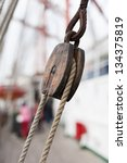 Wooden Pulley With Ropes On Deck
