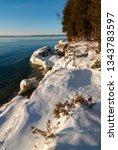 Snow covers the Lake Michigan bluff and shoreline at Whitefish Dunes State Park in Door County, Wisconsin