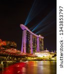 Small photo of SINGAPORE CITY, SINGAPORE - MARCH 1, 2019: Spectra Light and Water Show Marina Bay Sand Casino Hotel Downtown Singapore