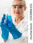 young woman scientist working... | Shutterstock . vector #1343886101