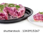 Stock photo partly sliced layered salad of diced pickled herring with boiled grated vegetables also known as 1343915267
