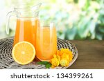Glass And Pitcher Of Orange...