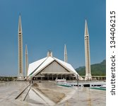 Small photo of ISLAMABAD - JULY 16: Faisal Mosque on July 16, 2011 in Islamabad. It is the largest mosque in Pakistan and South Asia and named after late King Faisal of Saudi Arabia who financed the project.