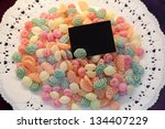 Candy background on the plate with black card - stock photo