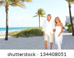 couple laughing at the beach... | Shutterstock . vector #134408051