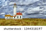 Small photo of PORT TOWNSEND, WA, USA - SEPTEMBER 23, 2018: The Point Wilson Lighthouse is an active aid to navigation located in Fort Worden State Park near Port Townsend, Jefferson County, Washington State
